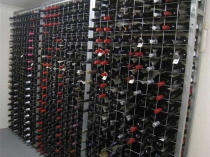 galvanised wine racks side by side in cellar