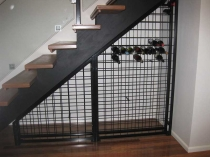 sloping top wine racks under stairs
