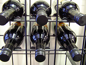 "They locate the bottles in the middle of each ""bay"" aligning the bottles so you get a perfect pattern of bottles enhancing the look of your Connoisseur Wine Cellar Racks."